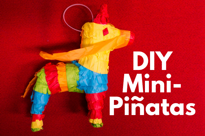 Image of a rainbow colored horse pinata against a red backdrop.