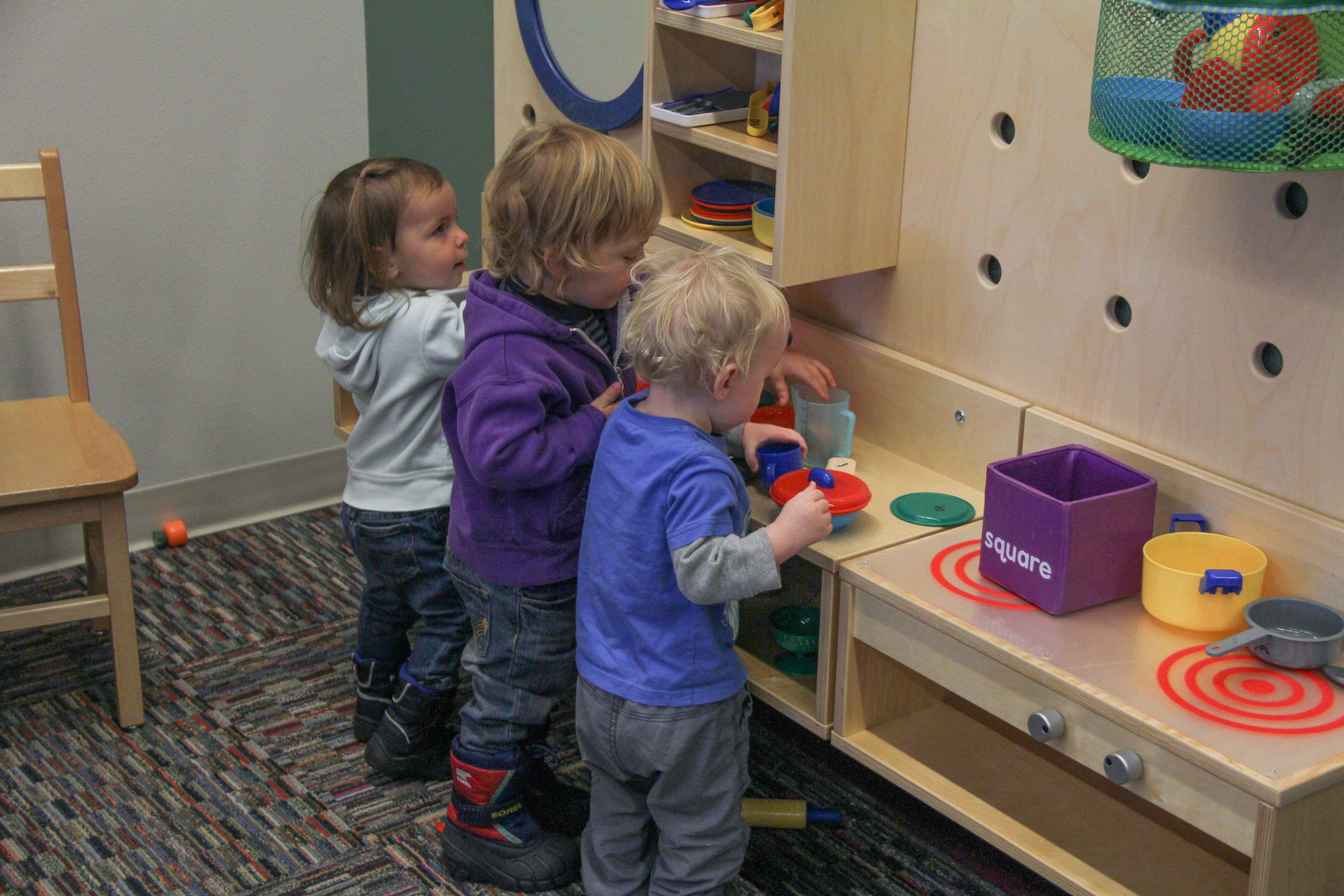 Children playing at a library early learning space